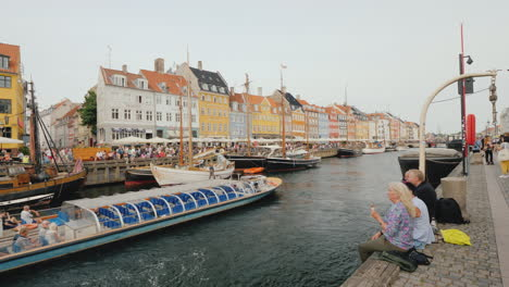 People-Relax-On-The-Shores-Of-The-Famous-Canal-In-Copenhagen