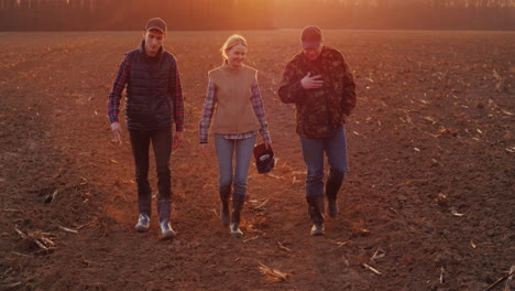 A-Successful-Family-Of-Farmers-Goes-On-A-Plowed-Field-4k-Video