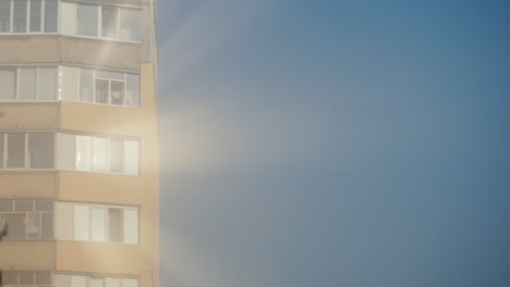 The-Sun-Is-Reflected-In-The-Windows-Of-A-High-Rise-Building