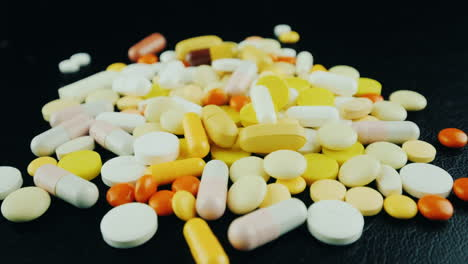 Hands-Move-A-Bunch-Of-Pills-And-Capsules