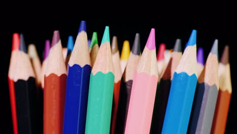 A-Set-Of-Multi-Colored-Pencils-On-A-Black-Background