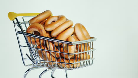 Small-Bagels-In-A-Shopping-Trolley-In-Miniature-4k-Video