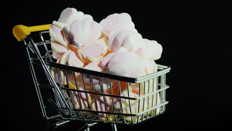 Sweets-In-A-Shopping-Trolley-On-A-Black-Background-4k-Video