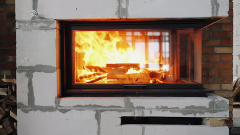 There-s-Firewood-Burning-In-The-Fireplace-Beautiful-Flame-In-Modern-Fireplace