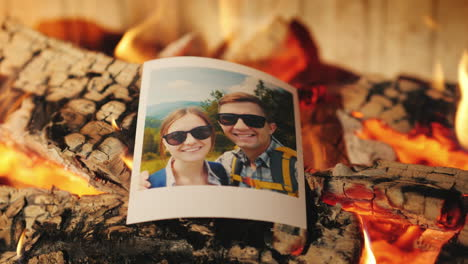 Family-Vacation-Photos-Burning-In-A-Fireplace