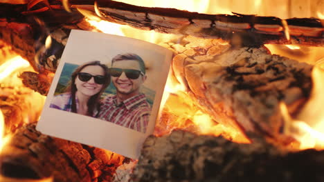 Portrait-Of-A-Loving-Couple-Burns-In-Fire-Parting-Concept