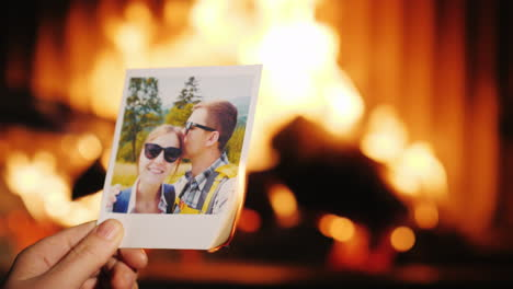 A-Man-Burns-A-Photo-Of-A-Couple-In-Love-And-Throws-It-Into-The-Fireplace