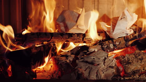 Crumpled-Pieces-Of-Paper-Documents-Are-Burned-In-A-Fireplace