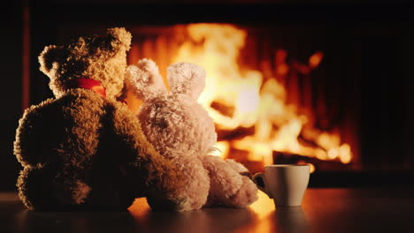 Tea-By-The-Fireplace-Two-Friends-Bear-And-Hare-Look-At-The-Fireplace-Next-To-A-Cup-Of-Tea