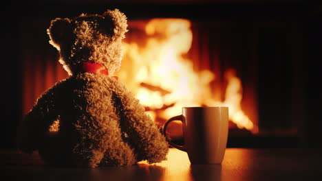A-Teddy-Bear-With-A-Big-Cup-Oh-Sitting-In-Front-Of-The-Fireplace
