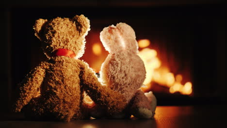 Bear-And-Rabbit-In-A-Hug-Sit-By-The-Fireplace-Valentine-s-Day-Concept
