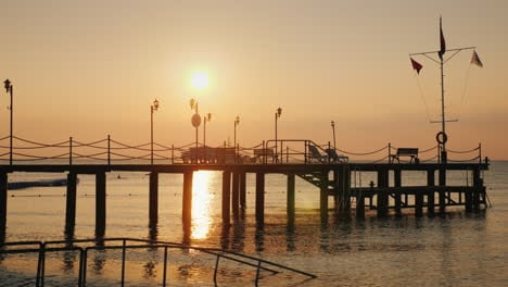 Dawn-Over-The-Sea-Silhouette-Of-A-Pier-That-Protrudes-Into-The-Water---A-Scenic-Landscape-Of-Summer-