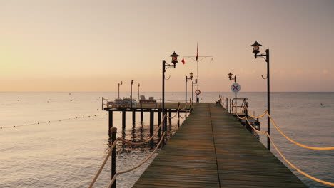 Walk-On-The-Pier-To-The-Sea-A-First-Person-View-Earlier-Morning-At-Sunrise-Steadicam-Shot
