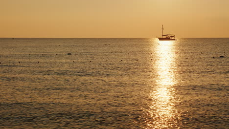 Fishing-Boat-In-The-Sea-At-Sunrise-A-Beautiful-Silhouette-In-A-Shiny-Path-On-The-Water-4k-Video