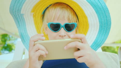 The-Child-Relaxes-After-Swimming-In-The-Pool---Plays-On-The-Smartphone