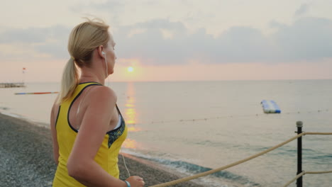 Active-Way-Of-Life-A-Young-Girl-In-Sportswear-Makes-A-Morning-Run-On-The-Pier-To-Meet-The-Sunrise