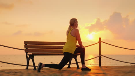 A-Young-Athlete-Makes-A-Morning-Warm-Up-On-The-Sea-Pier-Of-A-Cool-Morning-Against-The-Background-Of-
