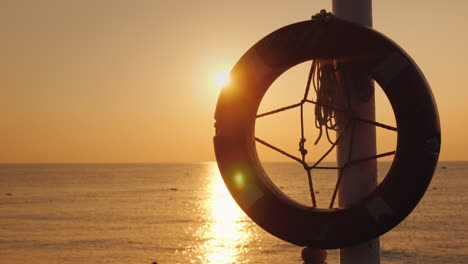 A-Lifeline-Hangs-Against-The-Backdrop-Of-The-Sea-Where-The-Sun-Rises-4k-Video
