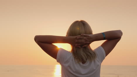 A-Young-Fair-Haired-Tourist-Meets-The-Dawn-On-The-Seashore-Relaxes-Enjoys-The-Silence-View-From-The-