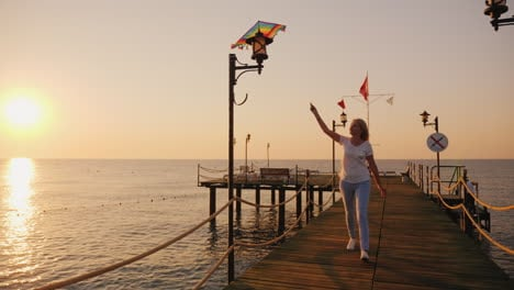 Woman-With-Kite-Runs-Along-The-Beach-Steadicam-Shot