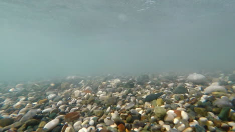 The-Sea-Surf-Fires-Pebbles-In-Different-Directions-The-Video-Was-Shot-Under-The-Water