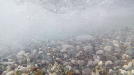Sea-Stones-Of-Different-Sizes-Sway-With-The-Surf-In-Different-Directions-Underwater-Shooting