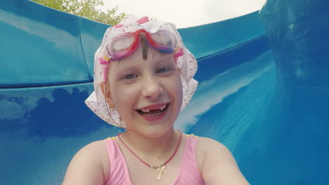 Funny-Girl-In-White-Panamke-Rides-From-The-Water-Slide-And-Makes-A-Ridiculous-Selfie-On-The-Camera