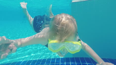 The-Girl-Is-Learning-To-Dive-In-The-Pool-She-Holds-His-Father-s-Hand-She-Wears-A-Mask-For-Scuba-Divi