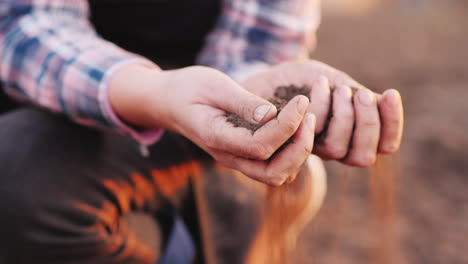 Young-Hands-Of-A-Woman-Farmer-Hold-Black-Soil-The-Beginning-Of-Spring-Work-In-The-Field-Organic-Farm