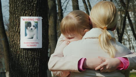 Mom-Soothes-The-Girl-Who-Lost-The-Dog-On-The-Tree-Hangs-The-Announcement-Of-The-Missing-Puppy