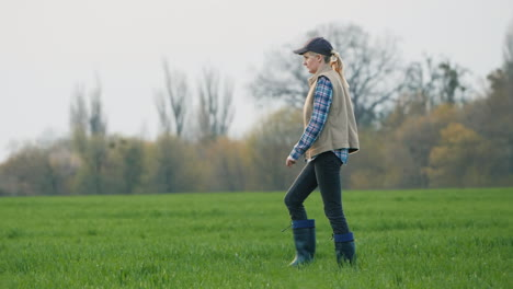 A-Woman-Farmer-Goes-To-Her-Field-Where-Winter-Wheat-Has-Sprouted