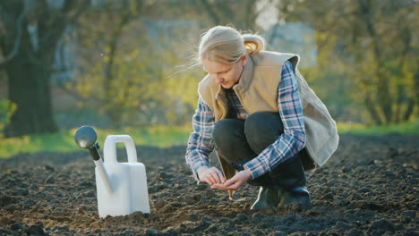 A-Woman-Farmer-Planting-Seeds-In-His-Garden-Spring-Work