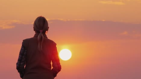 Silhouette-Of-A-Middle-Aged-Woman-Who-Goes-To-The-Setting-Red-Sun