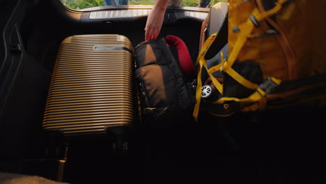Bags-And-Backpacks-Get-Out-Of-The-Trunk-Of-The-Car