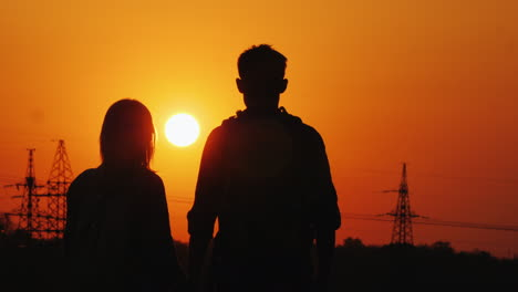 A-Couple-Of-Tourists-Admiring-The-Sunset-Over-The-City-Rear-View