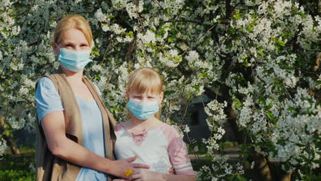 Woman-With-Children-In-Gauze-Bandages-Against-The-Background-Of-Flowering-Trees-Allergy-Problems-In-