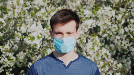A-Man-In-A-Gauze-Bandage-Against-A-Background-Of-Flowering-Trees-Allergy-During-The-Spring-Flowering