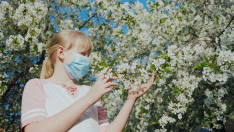 Sad-Child-In-A-Mask-Is-Admiring-A-Flowering-Tree-Allergy-Problems