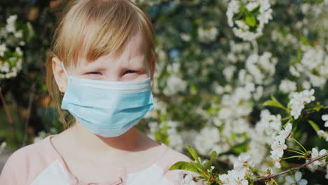 Portrait-Of-A-Child-In-A-Gauze-Bandage-Against-The-Background-Of-Flowering-Trees-Allergy-Problems