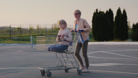 Woman-Having-Fun-In-The-Parking-Lot-At-The-Supermarket-Rolls-The-Child-In-The-Shopping-Trolley