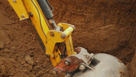 Excavator-Bucket-Digs-A-Hole-For-Communications