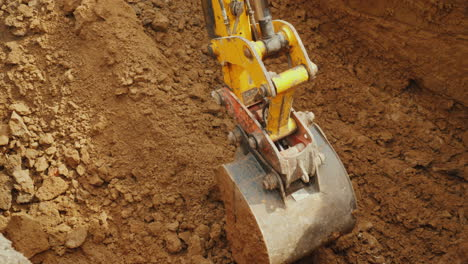 Large-Digger-Bucket-Extracts-Soil-From-Trench