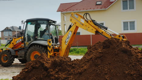 Excavator-Digs-A-Trench-Near-Private-Cottages