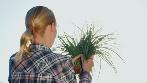 Woman-Farmer-Holds-Bunch-Of-Green-Onions-Vitamins-From-The-Farm