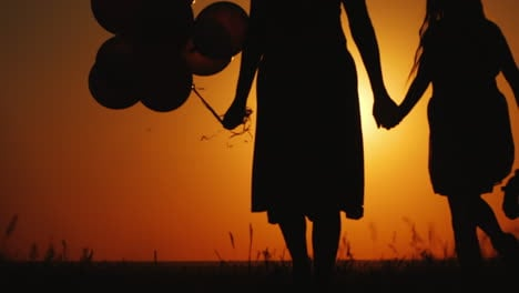Mom-And-Daughter-Walking-At-Sunset-Air-Balloon-And-Teddy-Bear-Are-Carried