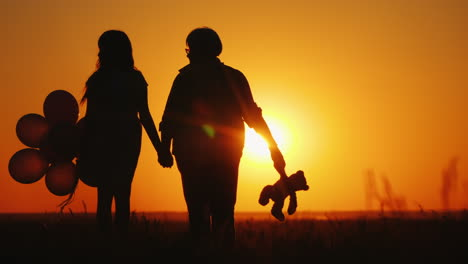 Grandmother-And-Granddaughter-Admire-The-Sunset-Together-Active-Seniors-Concept