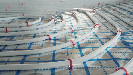 Underfloor-Heating-Pipes-Are-Laid-On-A-Special-Surface-Installation-Of-A-Heating-System