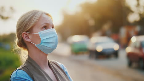 Dirty-Air---A-Woman-In-A-Gauze-Bandage-Stands-Near-A-Road-Loaded-With-Vehicles-Ecology-Problems-Conc