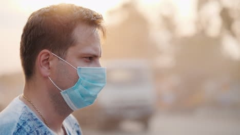Man-In-A-Protective-Mask-On-A-Dusty-Road-Ecology-Problems-Concept
