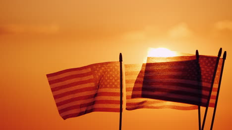 Several-American-Flags-Against-The-Setting-Sun-And-Orange-Sky